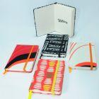 MAIO GR�FICA - Bloco personalizado tipo Moleskine/Riskiny. Capa em tecido. Formatos: 9x13cm. Miolo com 160 p�ginas. Papel Creme 80 grs.