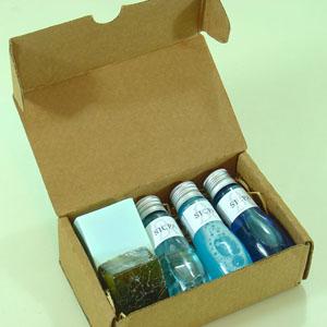 Brindes da Terra - Kit banho com mini estojo, shampoo, condicionador e loção hidratante.