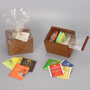 Kit com 12 sachês de chá variados e embalados em caixinha de MDF com tampa corrediça em acrílico. - Brindes da Terra