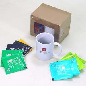 Mini kit de chá com 6 sachês e caneca. - Brindes da Terra
