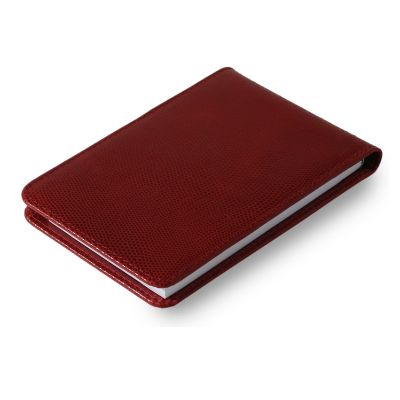 Bloco de anotações em couro vermelho.