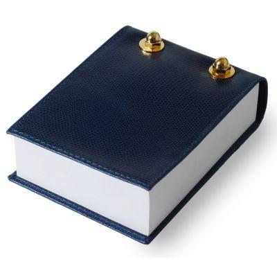Bloco de anotações em couro azul.