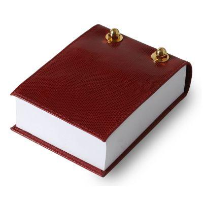Bloco de anotações de couro vermelho.