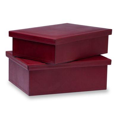 Jogo de caixas organizadoras em couro vermelho.