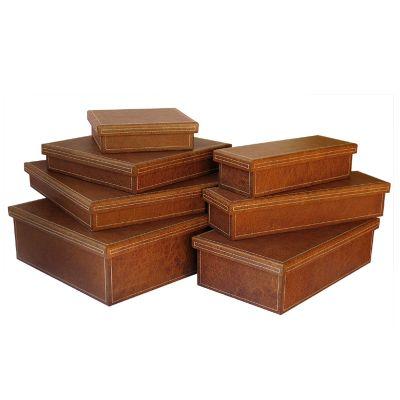 Jogo de caixas organizadoras em couro marrom.