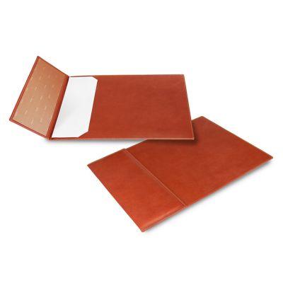 Risque-rabisque em couro telha, com apoio de mesa.