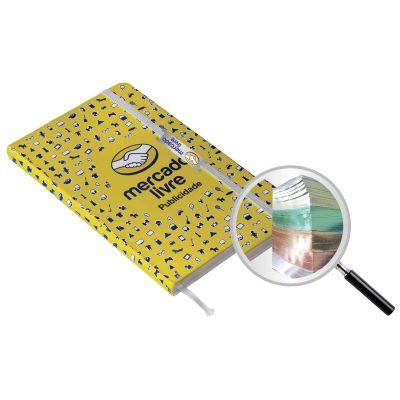 I9 Brindes - Moleskine personalizado, miolo com lombada colorida com aplicação de hot-stamp.
