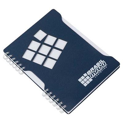 Caderno Capa em cartão revestido com Papéis Especiais, recorte lateral, logotipo vazado a laser, embalagem caixa cartão branco
