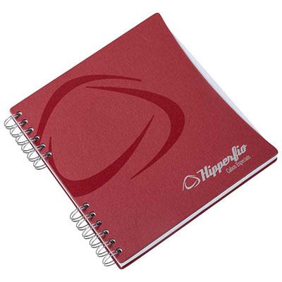 Caderno com capa em cartão revestido com Papéis Especiais, recorte lateral, embalagem em caixa de cartão branco