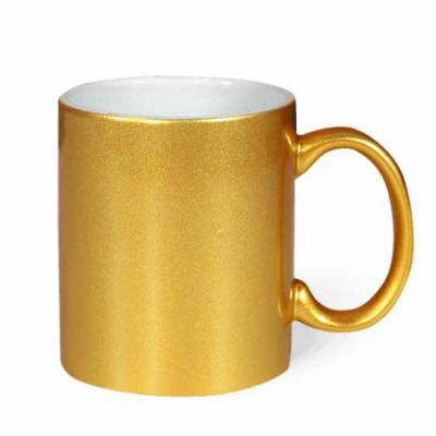 Nexo Brindes - Caneca de Cerâmica Dourada cintilante  Dimensões: Altura: 9 cm    Diâmetro: 8 cm  Área de Gravação: 19x8 cm  Capacidade: 325 ml  SUA MARCA APLICADA EM...