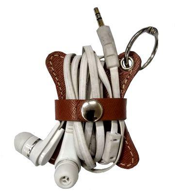 up-couro - Porta fone de ouvido, em couro ou sintético, pespontado. Medida: 5 x 6 cm