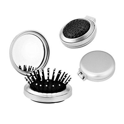 Escova com espelho de material plástico.