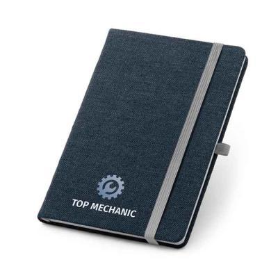 Caderno capa dura. Jeans. 96 folhas pautadas. Bolso interior. Suporte para esferográfica. Esferog...