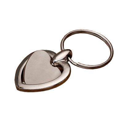 - Chaveiro metal giratório formato coração, possui chapa central de coração com ambos lados lisos. Medidas aproximadas para gravação (CxD): 2,1 cm x 2,2...