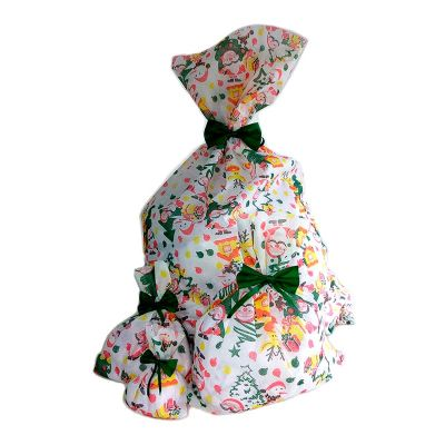 GriffiPett - Sacos para presente com estampa de Natal. Estampa única. Enfeite de laço incluso nas cores: verde e vermelho. Tamanhos: N1 16x25cm, N2 22x30cm, N3 34x...