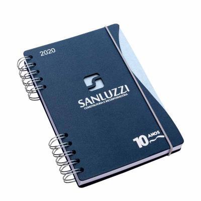 Agenda diária com capa: 145 x 205 mm, contra capa cartão revestido com papeis especias. Miolo: 14...