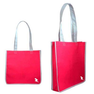 - Sacola promocional com fole lateral, alça de mão no próprio material, acabamento externo no próprio material