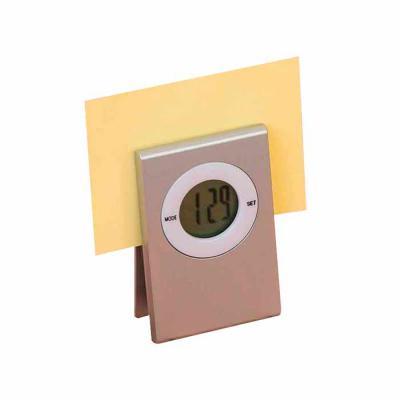 thap-papeis-e-brindes - Relógio de mesa prendedor personalizado. Ideal para sala de reuniões, possui deixar recados e anotações sempre próximos e organizados.