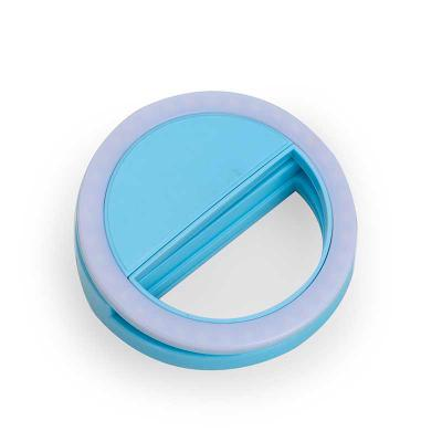 """Anel de iluminação para celular, utilizado para fotos em formato selfie. """"Ring light"""" plástico no formato """"presilha"""" para encaixe, possui três estágio... - Spaceluz Brindes"""