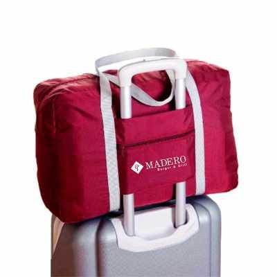 Bolsa viagem com encaixe para mala, disponível em diversas cores, produzida em nylon 210, possui dupla alça de ombro e bolso frontal. Medidas 48x32x16... - Canal Promocional