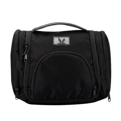 Necessaire em poliéster ideal para viagens. No compartimento principal você pode guardar produtos que não possam ficar deitados. Dois bolsos organizad...