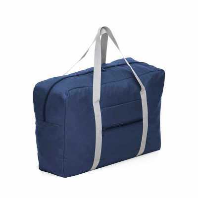 Bolsa de viagem dobrável confeccionada em poliéster e alça para mãos em nylon. Possui bolso principal na parte superior, bolso frontal também utilizad... - Box Brindes