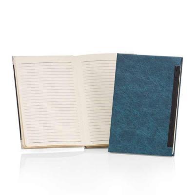 Caderno de anotações com porta objetos na capa