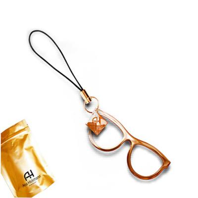 - Chaveiro óculos, fabricado em metal fundido, com acabamentos e cores variadas como grafite, cobre, latão, ouro, prata, dourado, com cordão de alta res...