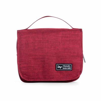 Marketing Brindes - Necessaire organizadora em tecido nylon Oxford, abertura frontal por velcro e alça superior, parte interna com gancho plástico; bolso interno superior...