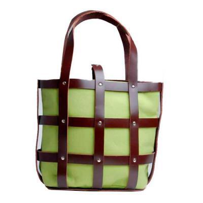 Bolsa de couro com saco de lona intercambiável