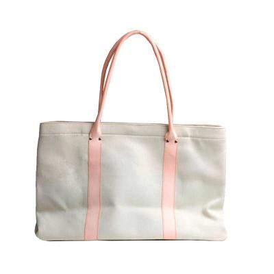 Bolsa de lona com alça de couro