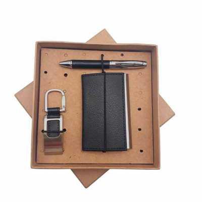 Kit com porta cartão, chaveiro e caneta metal em embalagem kraft