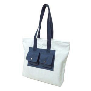 Ecofábrica - Bolsa Personalizada em algodão, com dois bolsos frontais com fechamento através de botão de pressão - Dimensões: 39 x 41 x 11 cm.