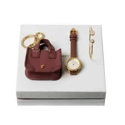 lamarca-brindes - Kit pulseira, chaveiro e relógio Cacharel. Pulseira em prata. Chaveiro em c. sintético. Relógio com pulseira em couro, pilha SR626SW inclusa e resistê...